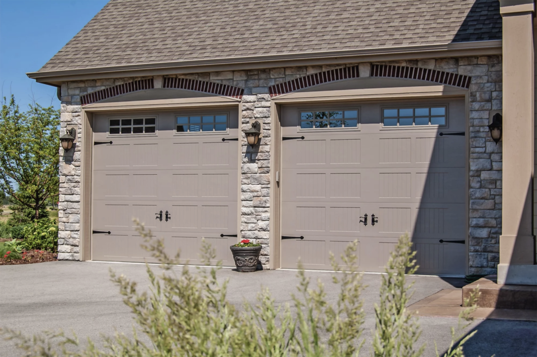 carriage garage doors on stone home